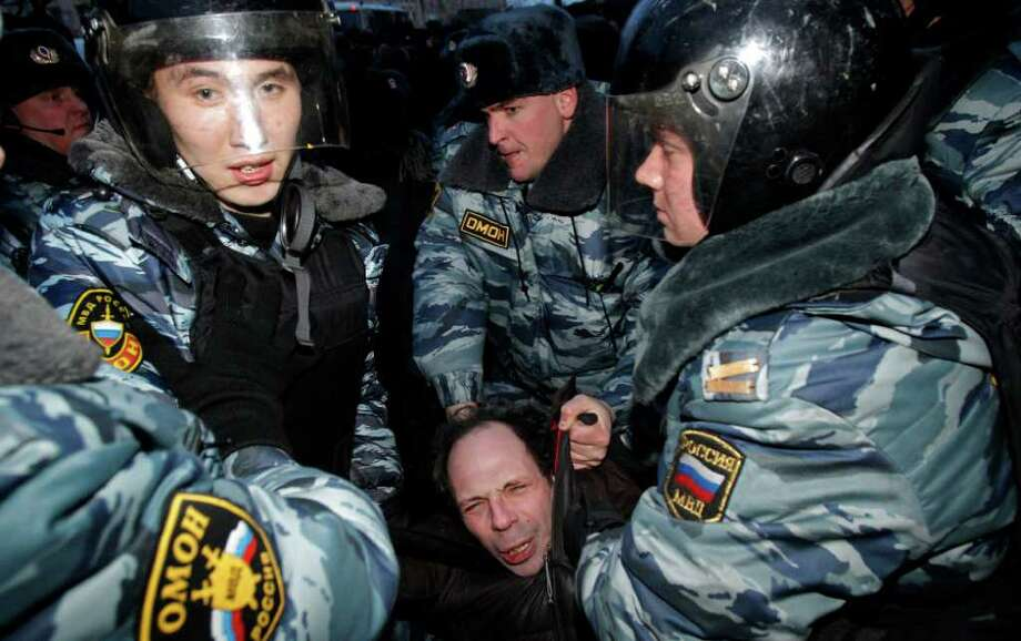 Russian police officers detain an opposition protester during a protest near the Central Election Committee in Moscow, Monday, March, 5, 2012. Demonstrators are contesting the outcome of the vote, pointing to a campaign heavily slanted in Putin's favor and to reports of widespread violations in Sunday's ballot. (AP Photo/Ivan Sekretarev) Photo: Ivan Sekretarev, Associated Press / AP