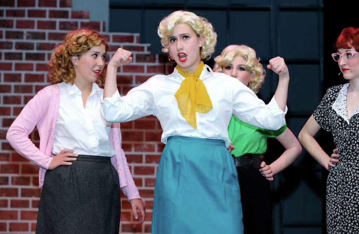 """From left, Katey Loughran, Mallory Feldman, Christina D'Aiuto and Mattie Joyner perform a song from """"The Pajama Game"""" during a rehearsal for the production at Ridgefield High School. Photo taken Friday, March 2, 2012."""