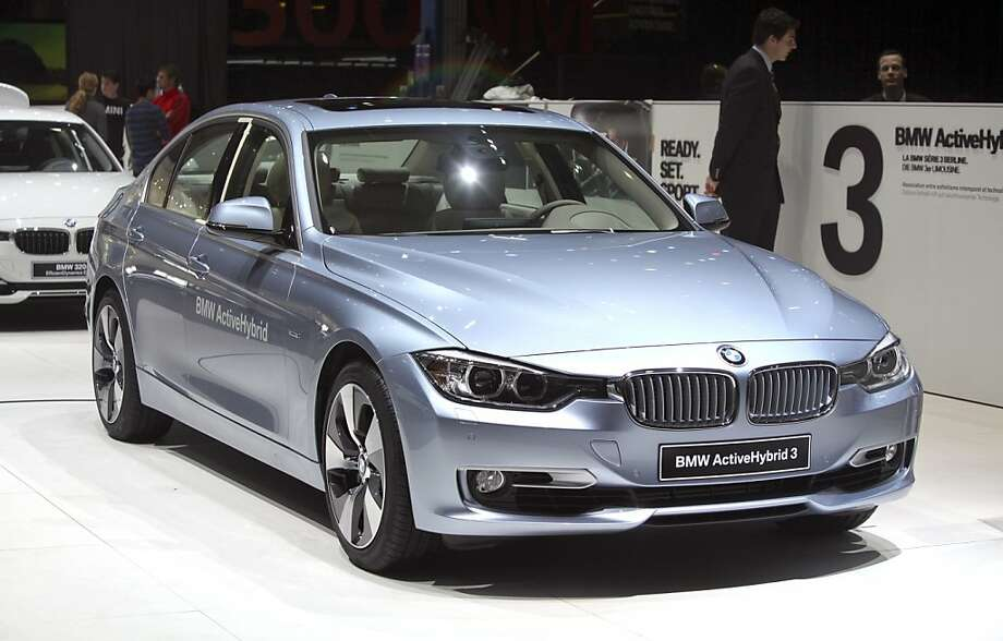 A Bayerische Motoren Werke AG (BMW) 3 Series ActiveHybrid 3 automobile is seen on the company's stand, ahead of the opening press day at the Geneva International Motor Show in Geneva, Switzerland, on Monday, March 5, 2012. The 82nd Geneva International Motor Show will showcase the latest models from the auto industry's leading manufacturers at the Palexpo exhibition centre this week. Photographer: Chris Ratcliffe/Bloomberg Photo: Chris Ratcliffe, Bloomberg