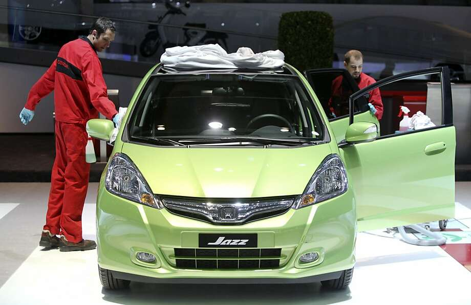 Employees work to prepare a Honda Jazz automobile on the company's stand, ahead of the opening press day at the Geneva International Motor Show in Geneva, Switzerland, on Monday, March 5, 2012. The 82nd Geneva International Motor Show will showcase the latest models from the auto industry's leading manufacturers at the Palexpo exhibition centre this week. Photographer: Chris Ratcliffe/Bloomberg Photo: Chris Ratcliffe, Bloomberg