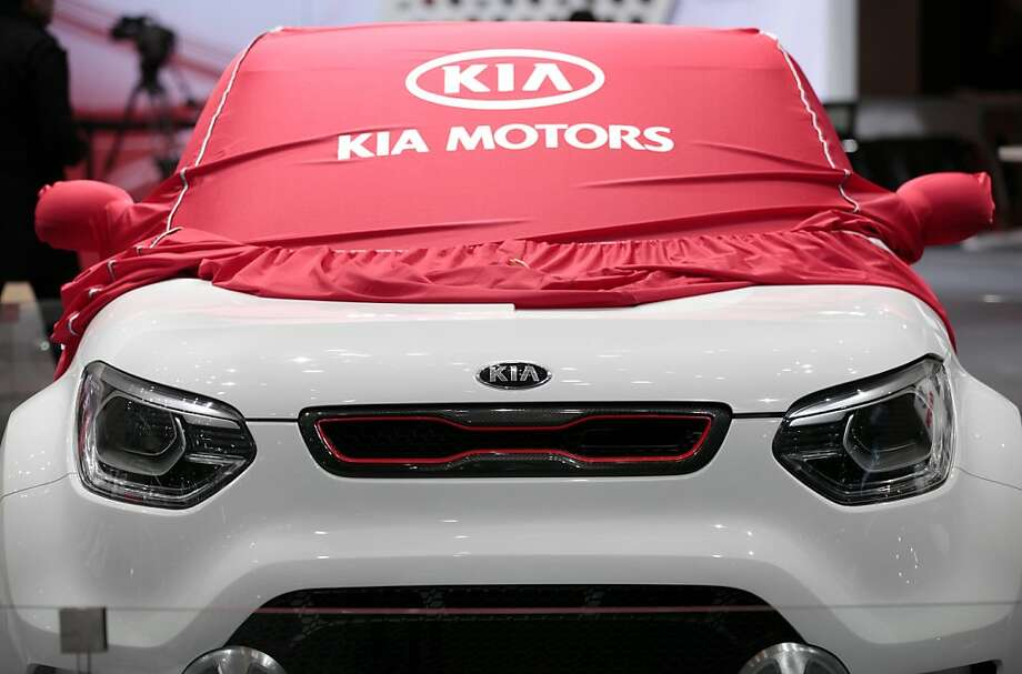 A protective cover sits over a Kia Trackster automobile, ahead of the opening press day at the Geneva International Motor Show in Geneva, Switzerland, on Monday, March 5, 2012. The 82nd Geneva International Motor Show will showcase the latest models from the auto industry's leading manufacturers at the Palexpo exhibition centre this week. Photographer: Jason Alden/Bloomberg Photo: Jason Alden, Bloomberg
