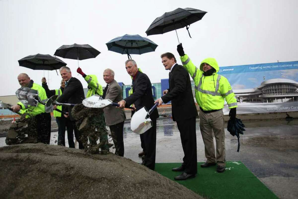 From left, 777 maintenance technician Bob Horton, Lufthansa manager of aircraft delivery Matthias Baschant, Boeing director of site services Michael Frank, VP and GM of the 787 program Larry Loftis and VP of the Everett Delivery Center Jeff Klemann turn shovels during the groundbreaking ceremony for Boeing's Everett Delivery Center on Monday, March 5, 2012 at Paine Field in Everett.