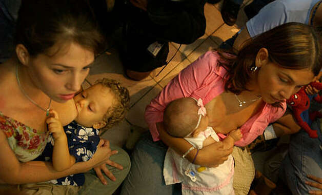 Mothers nurse their children on the floor of the Plaza Las Americas Mall during a nurse-in in Puerto Rico. (ASSOCIATED PRESS)