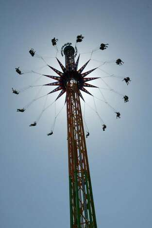 A 200-foot-tall tower ride, the SkyScreamer, is set to open Six Flags Fiesta Texas San Antonio's 2012 season. The ride features open-air swings that will twirl riders in a circle around the tower at a top speed of 40 mph. The ride is already operating at the amusement park's facilities in St. Louis, Mo., shown here, and Vallejo, Cal. Photo: COURTESY OF SIX FLAGS FIESTA TEXAS