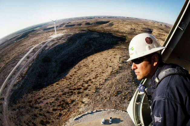 Manny Dominguez, Deputy Facility Manager of the BP Sherbino Mesa II Wind Farm, looks out from 285ft atop turbine 53, BP's 1000th wind turbine, Monday, Feb. 20, 2012, in Fort Stockton.  After cutting its solar program last year, BP is beefing up its investments into wind energy and recently launched its fourth Texas wind farm, in Fort Stockton. On 20,000 acres in Pecos County, the Sherbino II farm has 60 wind turbines to generate enough electricity to power more than 175,000 homes. Photo: Michael Paulsen, Houston Chronicle / © 2012 Houston Chronicle