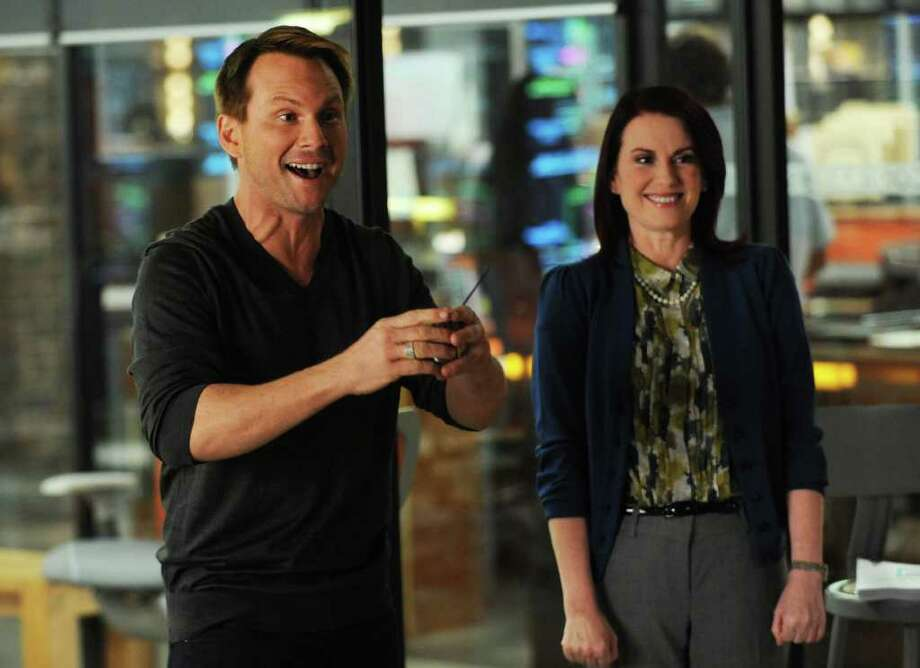 "Oz (Christian Slater) introduces Veronica Mann (Emmy Award-winning actress Megan Mullally) to the Contra staff in the second season premiere  of ""Breaking In"" on Fox. Photo: Ray Mickshaw"