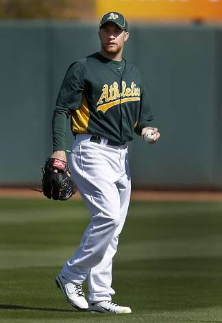 Left-handed reliever Sean Doolittle shags flyballs during batting practice before the Oakland A's Cactus League spring training opener against the Seattle Mariners in Phoenix, Ariz. on Friday, March 2, 2012. Photo: Paul Chinn, The Chronicle