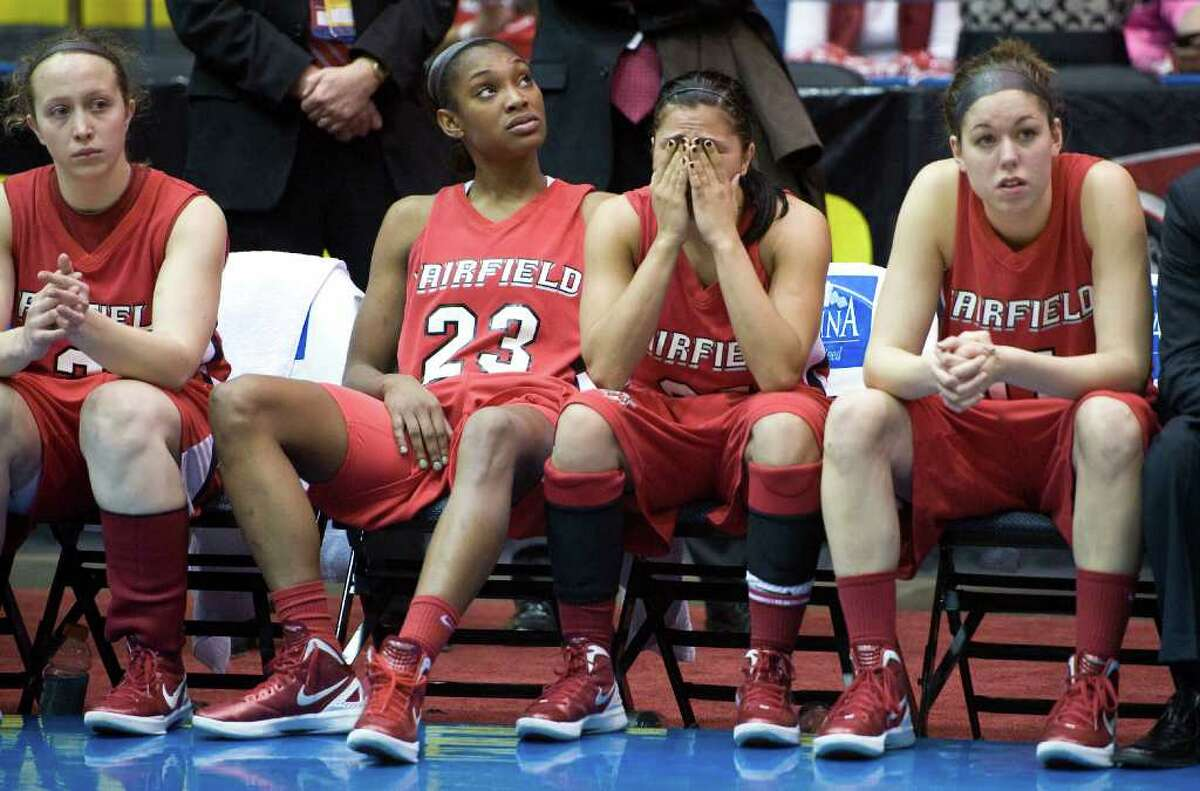 Fairfield players react after their 61-35 loss to Marist in an NCAA women's college basketball game for the championship of the Metro Atlantic Athletic Conference tournament in Springfield, Mass., Monday, March 5, 2012. (AP Photo/Jessica Hill)