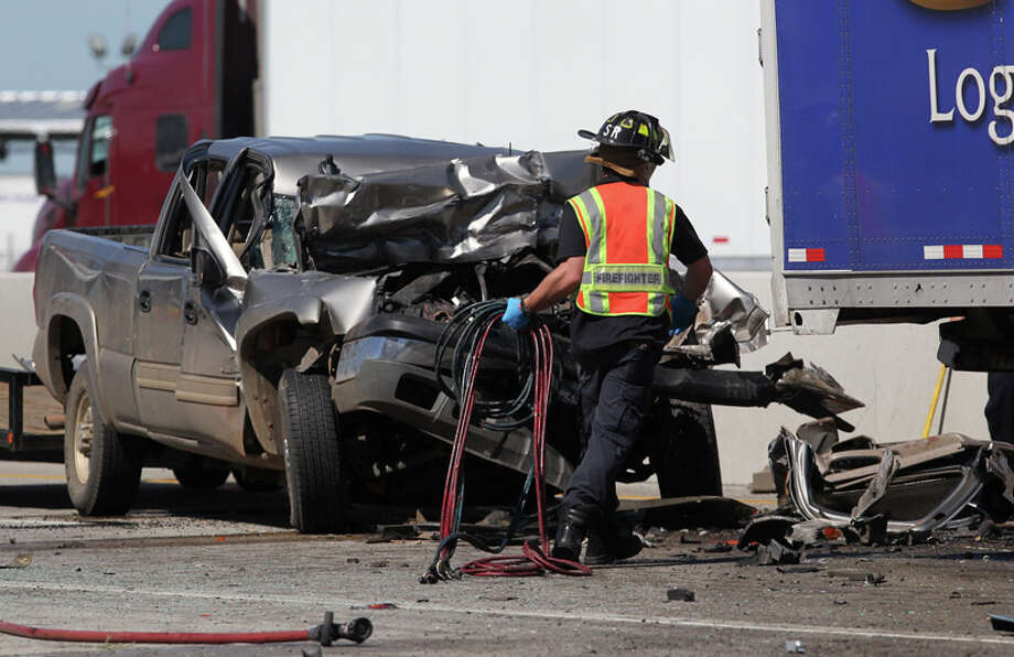 A Chevy pickup was the third vehicle involved in a fatal accident  Monday on Northeast Loop 410 near Dietrich Road and Interstate 10 East.  The driver of the pickup was taken to San Antonio Medical Center with  leg injuries. Photo: JOHN DAVENPORT, San Antonio Express-News / SAN ANTONIO EXPRESS-NEWS (Photo can be sold to the public)