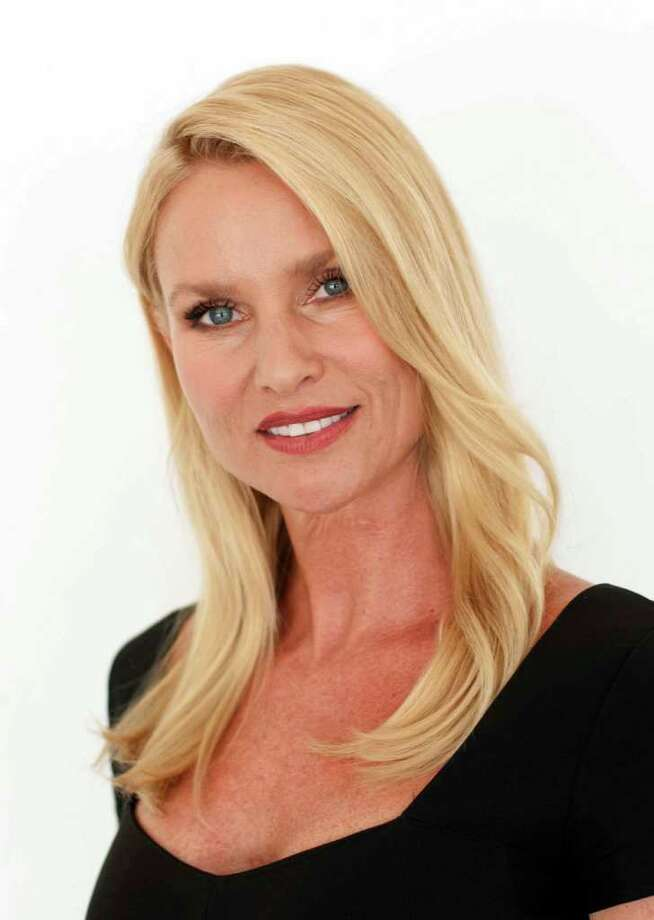 """FILE - In this July 27, 2011 file photo, actress Nicollette Sheridan poses for a portrait at during The Television Critics Association 2011 Summer Press Tour in Beverly Hills, Calif.  Sheridan concluded testifying Monday, March 5, 2012, in Los Angeles and """"Desperate Housewives"""" creator Marc Cherry told jurors he planned to kill off the actress' character four months before he allegedly hit her on the show's set in September 2008. (AP Photo/Dan Steinberg, file) Photo: Dan Steinberg"""