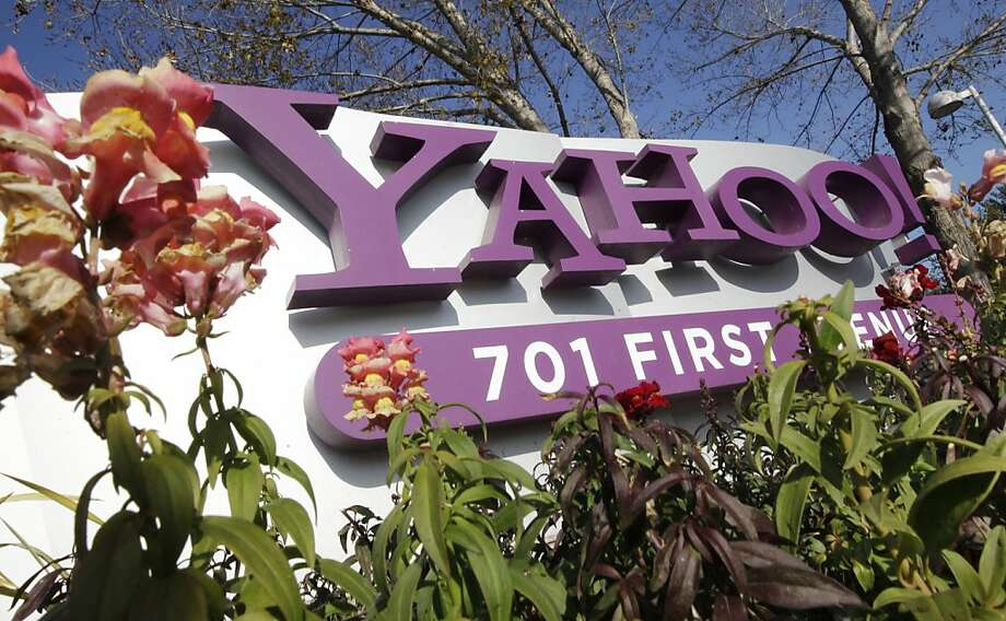 FILE - In this Jan. 4, 2012 file photo, the company logo is displayed at Yahoo headquarters in Sunnyvale, Calif. Yahoo Inc. on Tuesday, Feb. 7, 2012 announced that Chairman Roy Bostock and three longtime board members are stepping down, fulfilling the wishes of many frustrated shareholders who believe the directors have been part of the problem that has dragged down the Internet company's revenue and stock price. (AP Photo/Paul Sakuma, File) Photo: Paul Sakuma, Associated Press