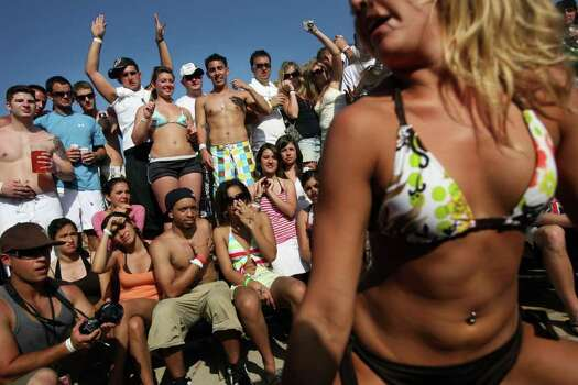 "SOUTH PADRE ISLAND, TX - MARCH 26:  Students participate in a ""booty shaking"" contest at the MTV Beach Bash party put on by Global Groove at the Bahia Mar Hotel during the annual ritual of Spring Break March 26, 2008 on South Padre Island, Texas.  The South Texas island is one of the top Spring Break destinations and attracts students from all over the country.  (Photo by Rick Gershon/Getty Images) Photo: Rick Gershon / Getty Images North America"