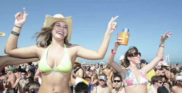 (left) Kayla Moncrief yells out from the crowd as she and other spring breakers enjoy  the music coming from the the Full Throttle Energy Spring Break stage during Texas Week in South Padre Island, Texas    Friday, March 14, 2008, in South Padre Island. ( Billy Smith II / Chronicle ) Photo: Billy Smith II / Houston Chronicle