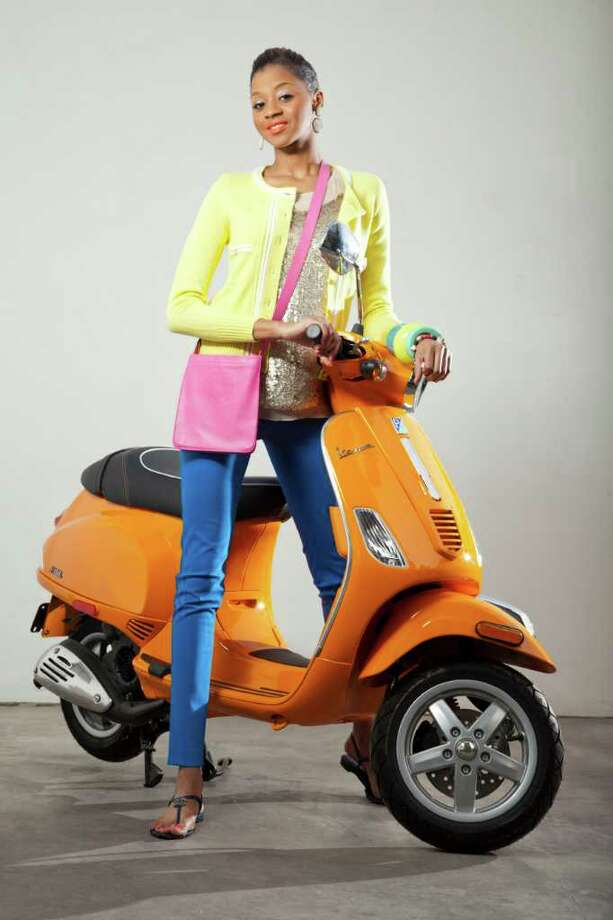 Pictured:  Orange vespa, Vespa of Texas, $4200, White sapphire pave diamond earrings, J/Hadley, $3250, Chanel chartreuse sweater, NM, $3280, Stella McCartney sequined tank, NM, $1085, Stella McCartney peg leg pants, NM, $765, Chanel thong sandals, NM, $625, Blue resin bangle, Hermes, $240, Seafoam resin bangle, Hermes, $240, Chartreuse resin bangle, Hermes, $260, Satchel purse, Hermes, $1000, Pave diamonds and bone charm bracelet, The Woods, $5200. Photo: Smiley N. Pool / © 2012  Houston Chronicle