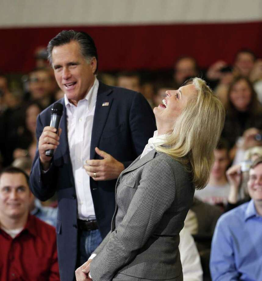 Ann Romney, wife of Republican presidential candidate, former Massachusetts Gov. Mitt Romney, laughs with him as he spoke at a town hall meeting at Taylor Winfield in Youngstown, Ohio, Monday, March 5, 2012. Photo: AP