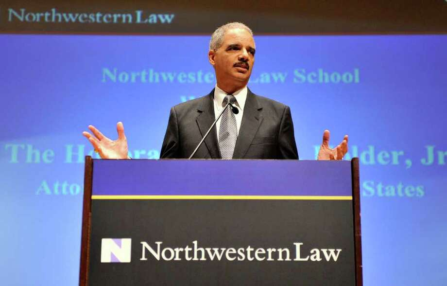 "Attorney General Eric Holder speaks at the Northwestern University law school, Monday, March 5, 2012 in Chicago. Holder said Monday that the decision to kill a U.S. citizen living abroad who poses a terrorist threat ""is among the gravest that government leaders can face,"" but justified lethal action as legal and sometimes necessary in the war on terror. (AP Photo/Brian Kersey) Photo: Brian Kersey / FR84753 AP"