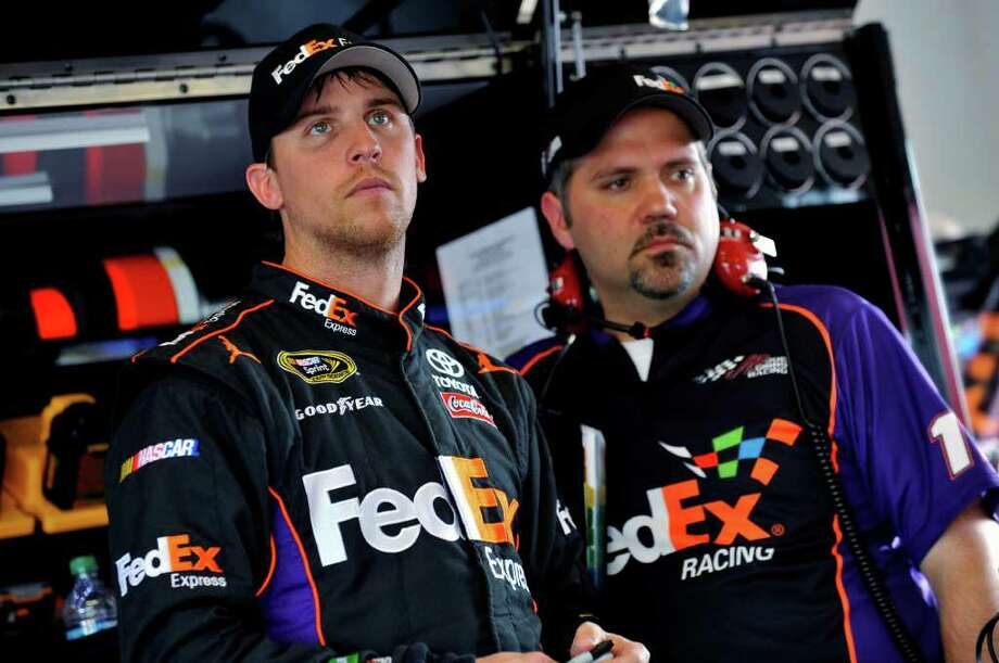 In this Feb. 18, 2012, photo, Denny Hamlin, left, and crew chief Darian Grubb stand in the garage during practice for the NASCAR Daytona 500 auto race at Daytona International Speedway in Daytona Beach, Fla. Grubb sure hasn't missed a beat since he was fired by Tony Stewart. Grubb led Hamlin to a win at Phoenix on Sunday, March 4, and the crew chief now has won six of the last 12 Sprint Cup Series races. (AP Photo/Autostock, Nigel Kinrade) Photo: Nigel Kinrade