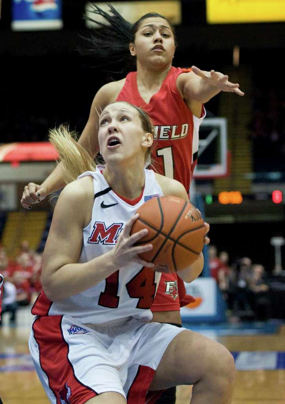 Marist's Casey Dulin, bottom, is guarded by Fairfield's Desiree Pina, top in the first half of an NCAA college basketball game for the championship of the Metro Atlantic Athletic conference women's tournament in Springfield, Mass., Monday, March 5, 2012. (AP Photo/Jessica Hill)