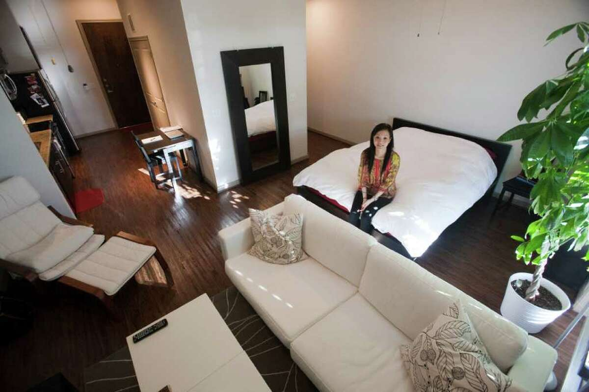 Jamie Lin sits in her 548-square-foot apartment in the Midtown area of Houston.