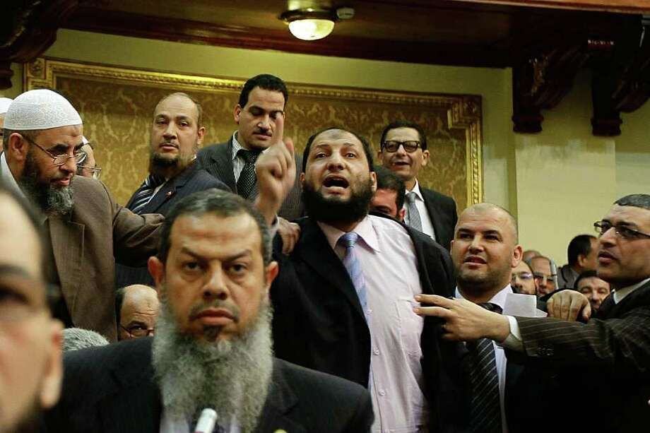 Egyptian lawmaker Anwar al-Balkimy, center, resigned because he got a nose job - forbidden by his sect - then lied about it, claiming he was beaten. Photo: Anonymous / AP