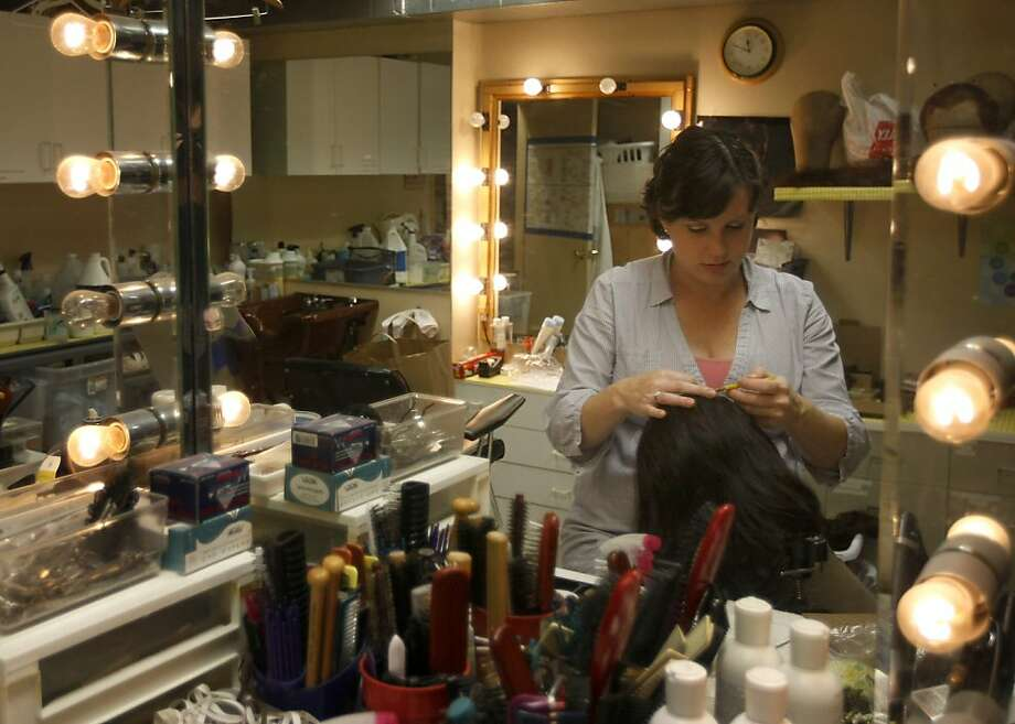 Hard at work, Jeanna Parham adds a few more strands of hair to a new wig. Jeanna Parham is American Conservatory Theater's Wig Master. She has been constructing and styling wigs for over twelve years. Photo: Sean Culligan, The Chronicle