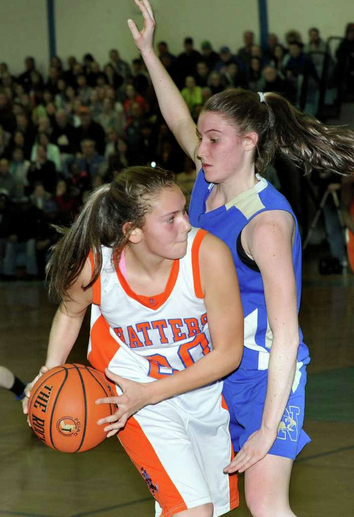 Left, for Danbury High, #20, Allie Smith. #10, Newtown High, Jess Lynch play in the Class LL state girls basketball tournament held at Danbury High School Monday, March 5, 2012.