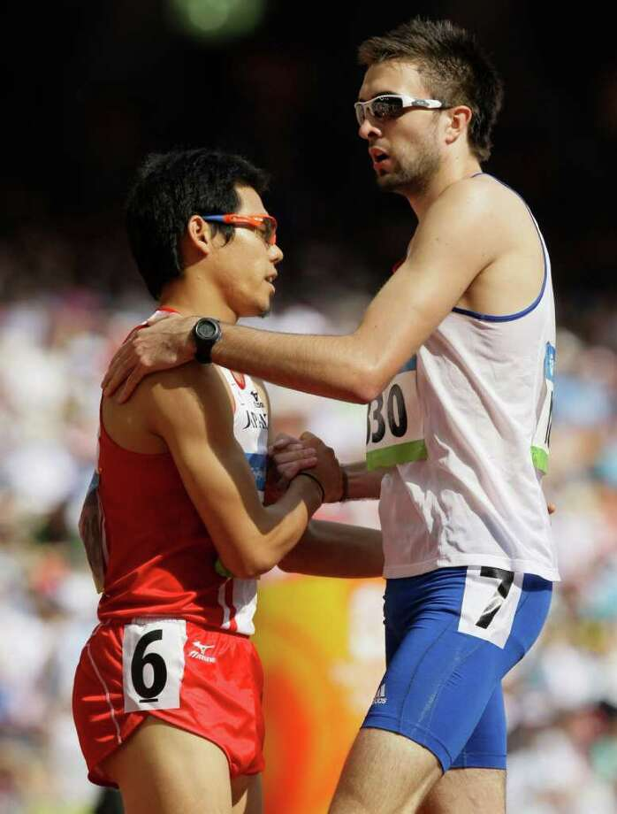 At the 2008 games in Beijing, Japan's Yuzo Kanemaru, left, and Britain's Martyn Rooney shake after a heat. Photo: Anja Niedringhaus / AP2008