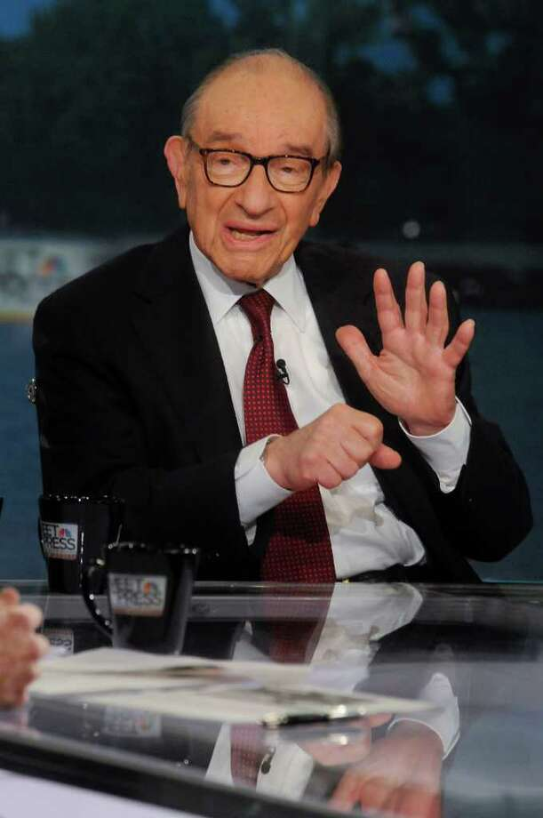 "In this photo provided by NBC News, Dr. Alan Greenspan, former chairman of the Federal Reserve, speaks on NBC's ""Meet the Press""  in Washington, Sunday, Aug. 7, 2011. Greenspan said he expects the stock market slide to continue Monday in the wake of a decision by credit rating agency Standard & Poor's to downgrade the U.S. credit rating. He said it will take time for the markets to bottom out, but he said he sees no risk in investing in the United States and says that S&P's downgrade won't change that.  (AP Photo/NBC News, William B. Plowman) Photo: William B. Plowman / NBC"