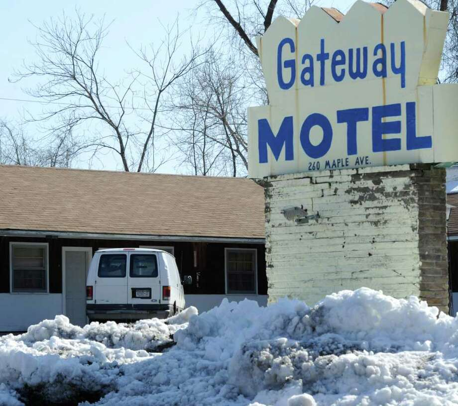 Brent G. Dickinson, 33, lived in the Gateway Motel in Saratoga Springs in room #9 shown to the left behind the sign March 5, 2012.  Dickinson is accused of threatening President Obama and school children in Saratoga Springs.    (Skip Dickstein / Times Union) Photo: SKIP DICKSTEIN / 2011