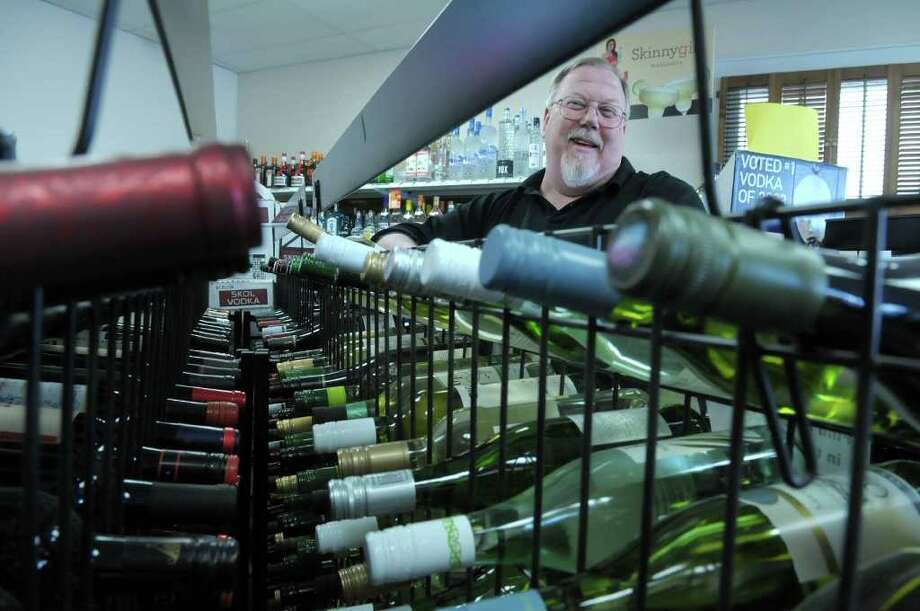 Jim Klump, owner of Scotia Wines and Spirits, poses in his store on Monday, March 5, 2012 in Scotia, NY.  Klump is excited about the county finally getting rid of restrictions on liquor stores to only be open until noon on holidays.  The Schenectady County Legislature has proposed to change the current restriction.  (Paul Buckowski / Times Union) Photo: Paul Buckowski