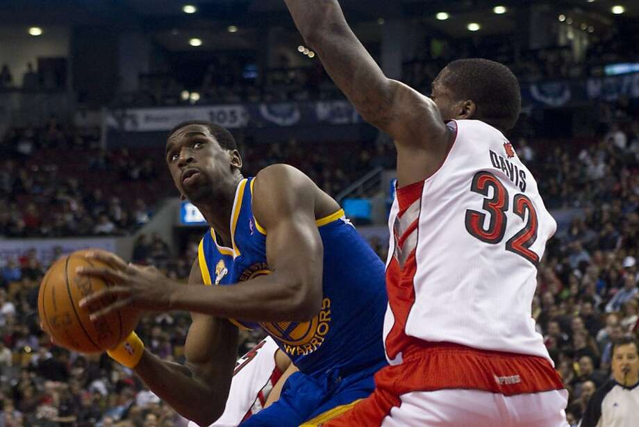 Golden State Warriors' Ekpe Udoh, left, tries to find a way past Toronto Raptors' Ed Davis during the second half of an NBA basketball game in Toronto on Sunday, March 4, 2012. (AP Photo/The Canaidan Press, Chris Young) Photo: Chris Young, Associated Press