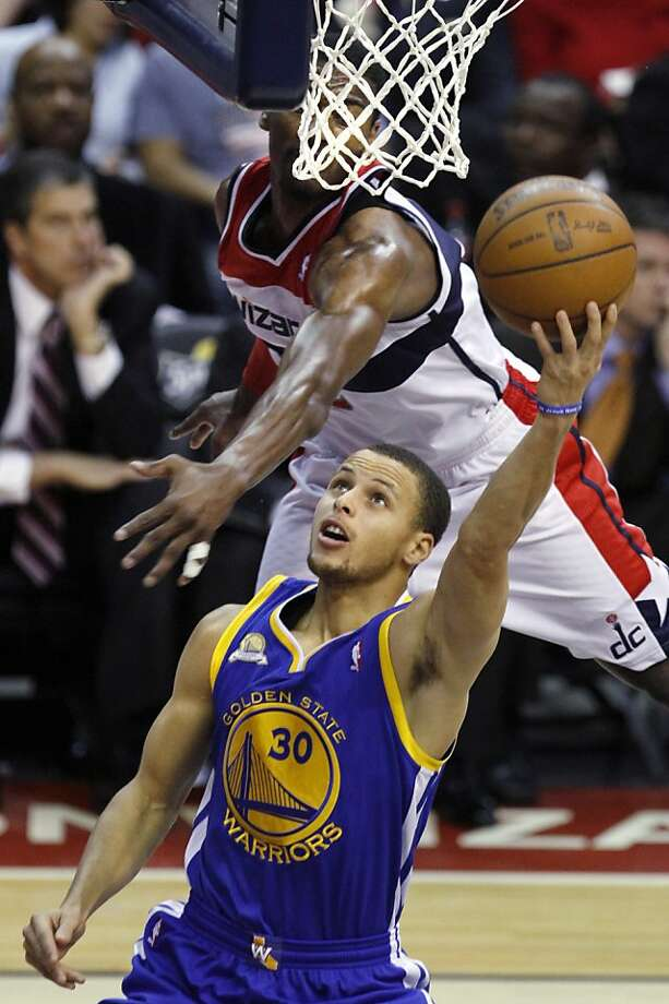 Golden State Warriors guard Stephen Curry (30) makes a basket while guarded by Washington Wizards John Wall during the third quarter of an NBA basketball game at the Verizon Center in Washington, on Monday, March 5, 2012. The Warriors won 120-100. (AP Photo/Jacquelyn Martin) Photo: Jacquelyn Martin, Associated Press