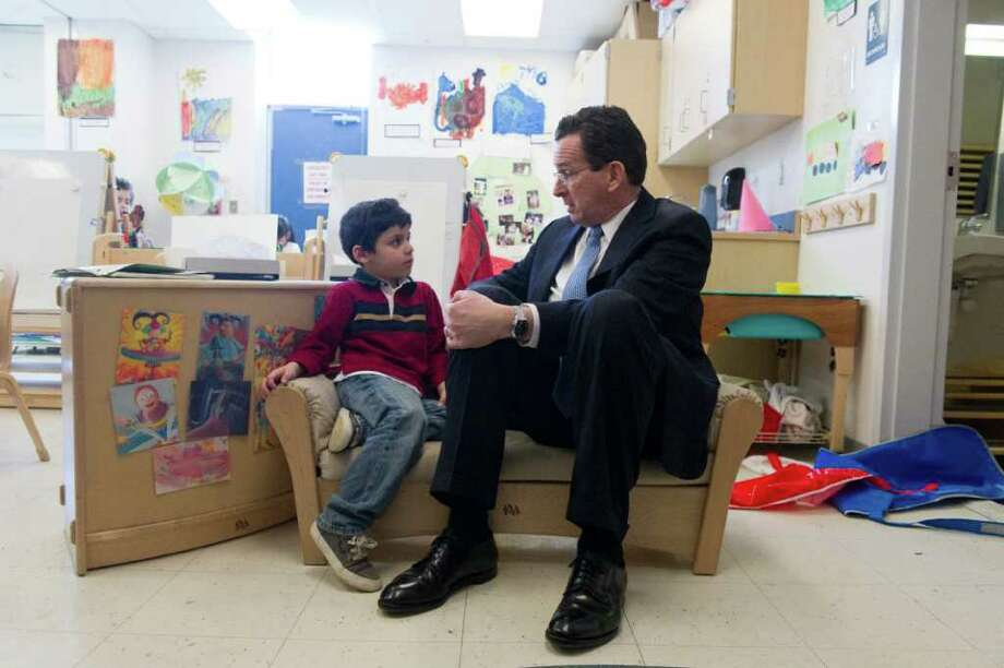 Governor Dannel P. Malloy speaks with Brandon Salguero as he and Norwalk legislators tour Brookside Elementary School in Norwalk, Conn., March 5, 2012. Photo: Keelin Daly / Stamford Advocate
