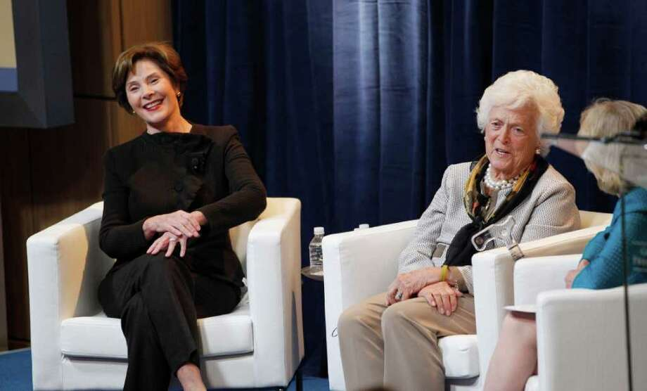 "Former first ladies Barbara Bush, right, and Laura Bush take part in a panel that was part of the conference ""America's First Ladies: An Enduring Vision,"" at SMU in Dallas, Monday, March 5, 2012.  (AP Photo/LM Otero) Photo: LM Otero / AP"
