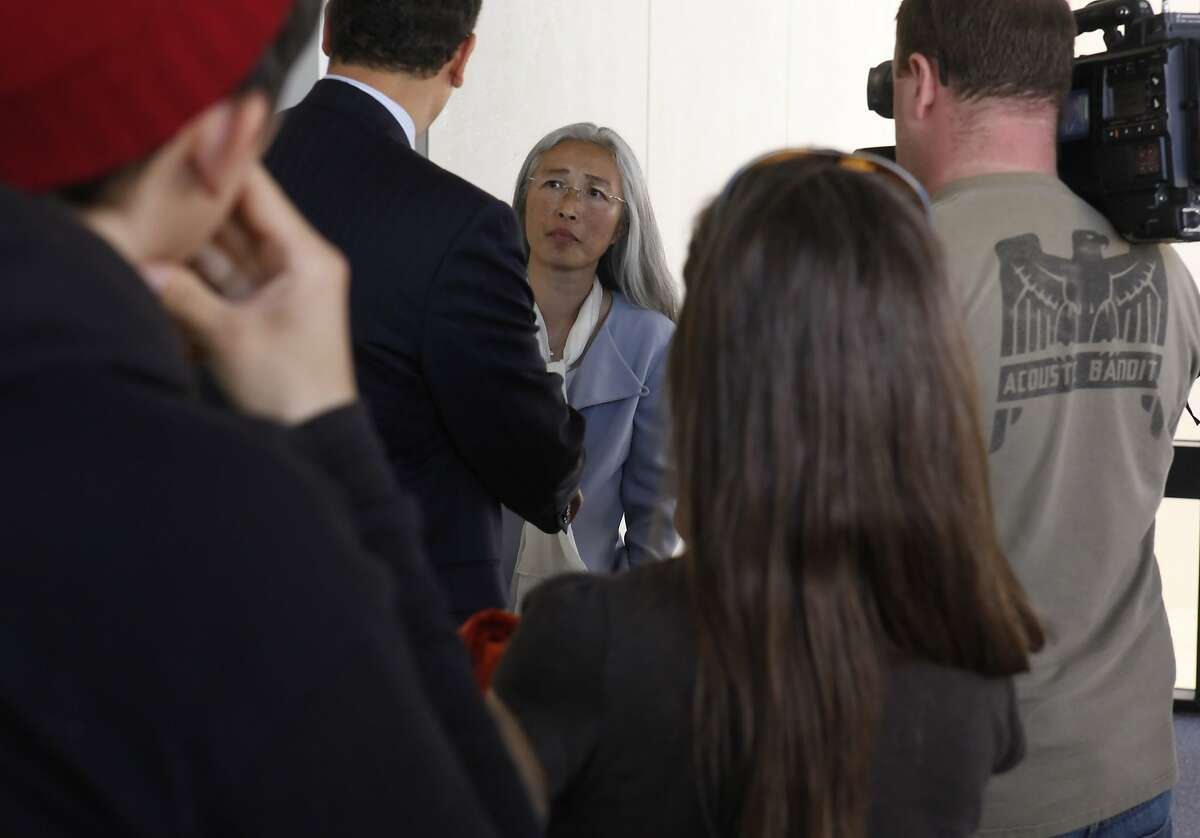 Yolanda Huang addresses questions about charges against three Occupy protesters at the Wiley Manuel Court House in Oakland, Calif., on Monday, March 5, 2012.