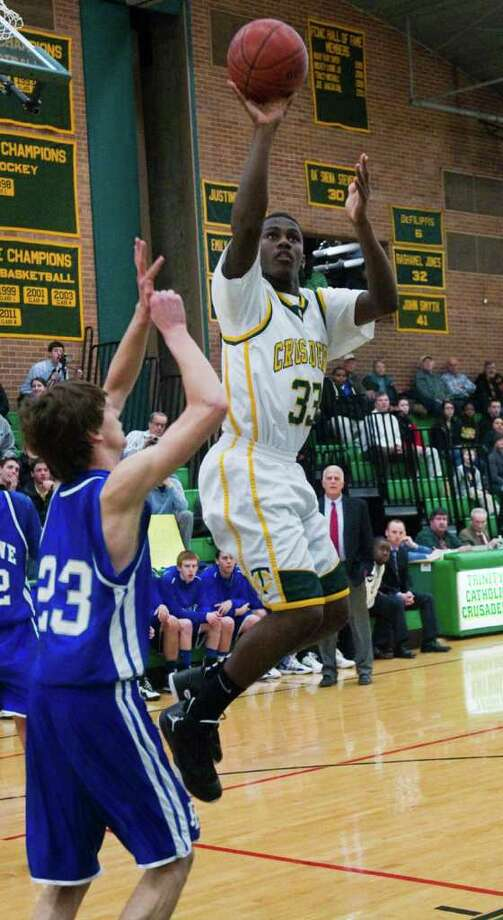 Trinty's Kevin Lemeune shoots Trinity Catholic High School hosts Ludlowe in a Class L Boys Basketball game in Stamford, Conn., March 5, 2012. Photo: Keelin Daly / Stamford Advocate
