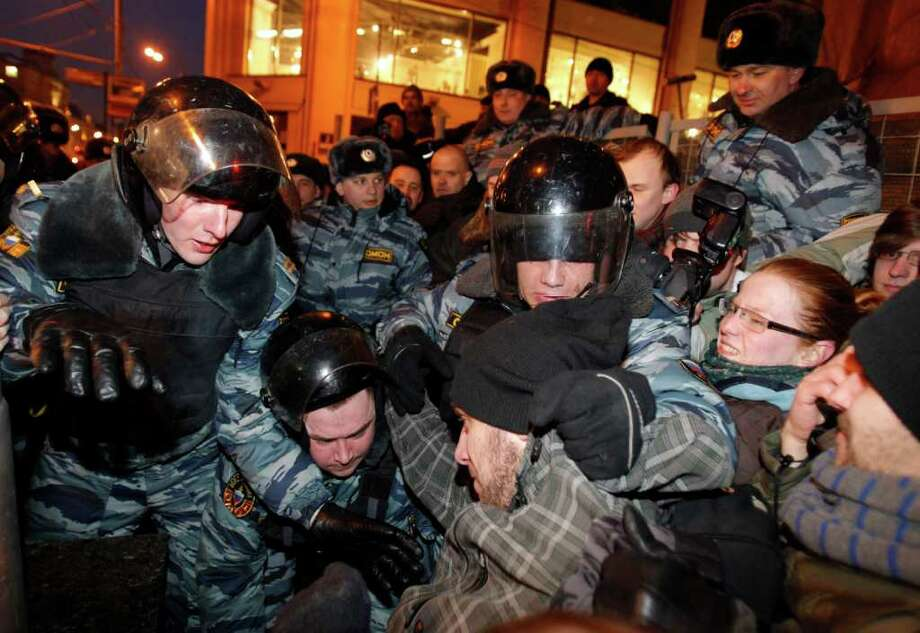 Russian police officers detain demonstrators attempting to hold an unsanctioned protest in Moscow, Monday, March 5, 2012. Demonstrators contested the outcome of the Russian presidential election Monday, pointing to a campaign heavily slanted in Russian Prime Minister Vladimir Putin's favor and to reports of widespread violations in Sunday's ballot.  (AP Photo/Ivan Sekretarev) Photo: Ivan Sekretarev / AP