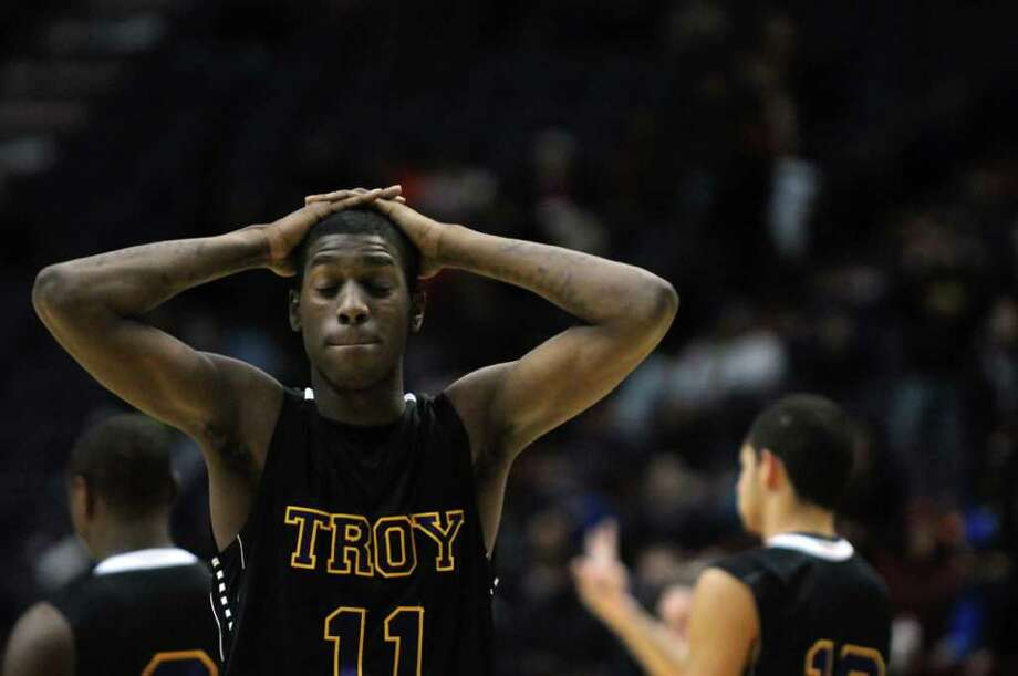 Troy's Trahmier Burrell on the court during their 62-57 overtime loss to CBA in the Section II Class AA boys basketball final at the Times Union Center on Monday night March 5, 2012 in Albany, N.Y. CBA won their fourth straight Section II crown, and were in the finals for the 10th straight time. (Philip Kamrass / Times Union ) Photo: Philip Kamrass / 00016679A