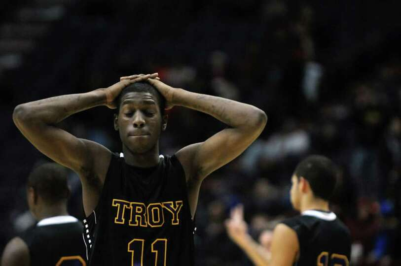 Troy's Trahmier Burrell on the court during their 62-57 overtime loss to CBA in the Section II Class