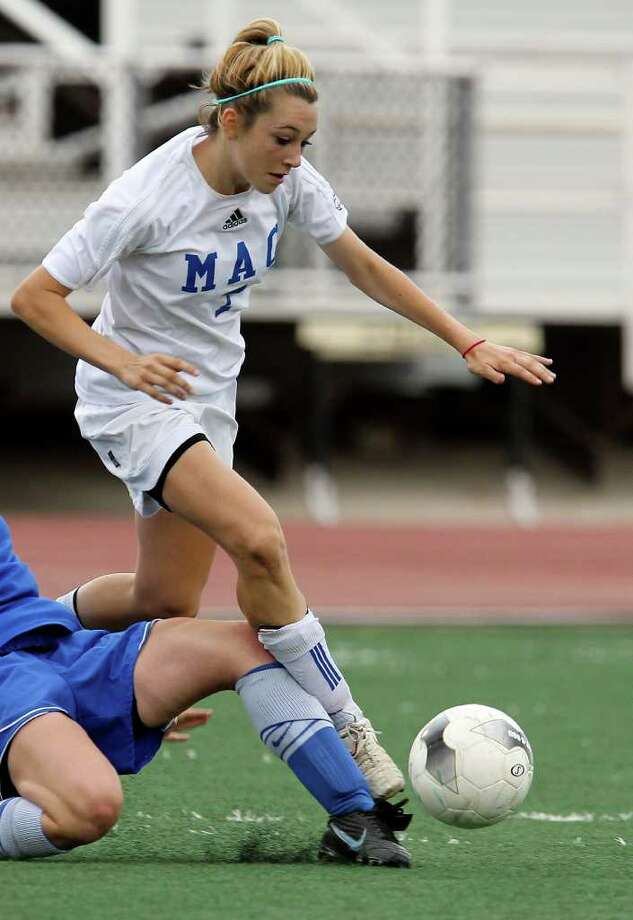 MacArthur midfielder Brianna Livecchi  — seen here during a 2011 game against New Braunfels — figured in five of her team's eight goals scored in victories over Johnson (4-2) and Roosevelt (4-1), and had three second-half goals against Johnson. Photo: KIN MAN HUI, San Antonio Express-News / San Antonio Express-News NFS
