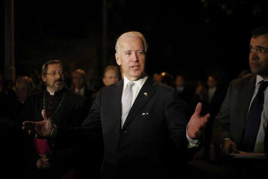 U.S. Vice President Joe Biden speaks to journalists during a visit to the Basilica of Guadalupe in Mexico City, Monday, March 5, 2012. Biden is on a one-day official visit to Mexico. (AP Photo/Alexandre Meneghini) Photo: Alexandre Meneghini / AP