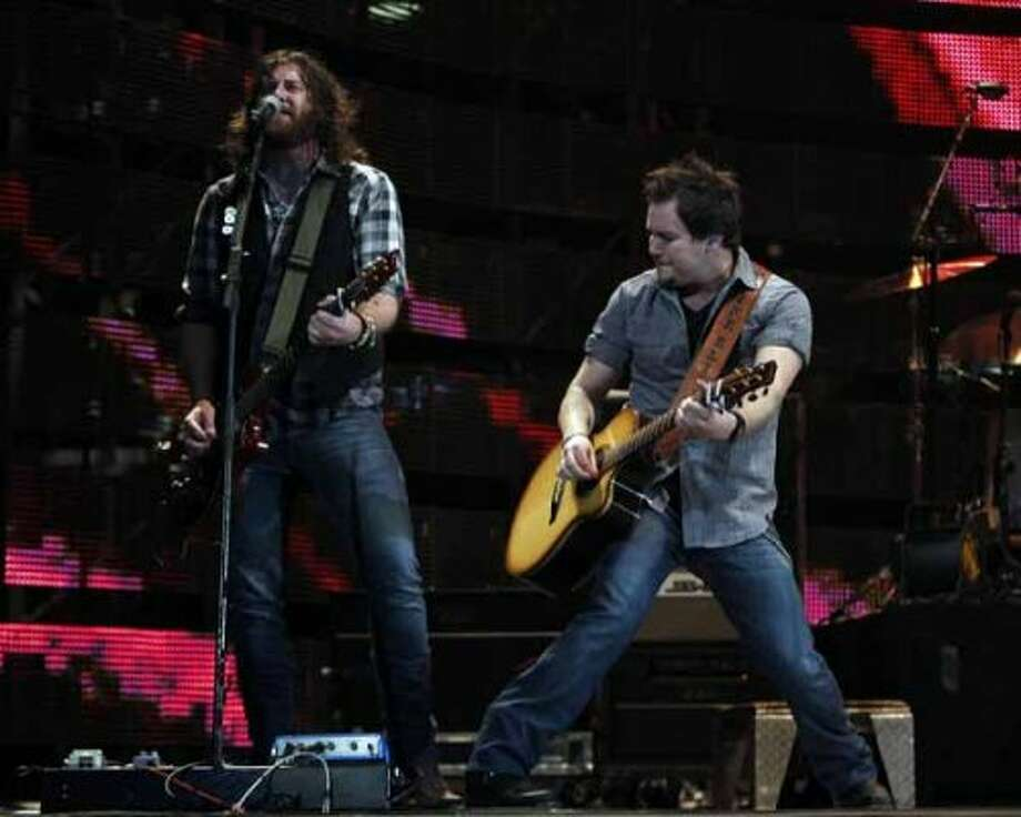 James Young, left, and Mike Eli with The Eli Young Band perform Monday, March 5, 2012, during the Houston Livestock Show and Rodeo at Reliant Stadium. (James Nielsen / Chronicle)