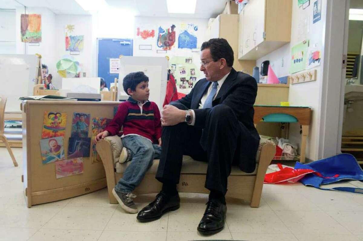 Governor Dannel P. Malloy speaks with Brandon Salguero as he and Norwalk legislators tour Brookside Elementary School in Norwalk, Conn., March 5, 2012.