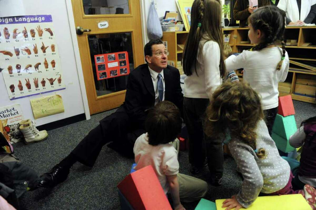 Governor Dannel P. Malloy chats with kids as he and Norwalk legislators tour the Norwalk Community College Child Development Lab in Norwalk, Conn., March 5, 2012.