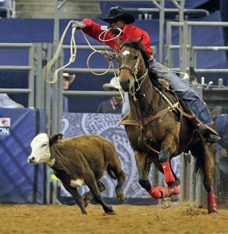 Cory Solomon looks to lasso his calf during the tie-down roping event at the Houston Livestock Show and Rodeo on Monday at Reliant Stadium. Photo: James Nielsen / © 2011 Houston Chronicle