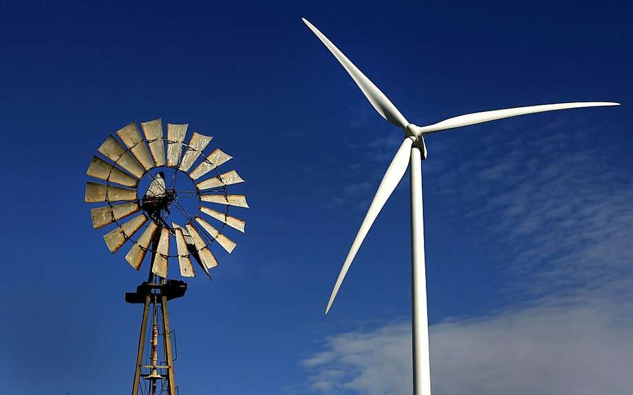A Vestas Wind Systems A/S turbine stands next to an old windmill at the Sacramento Municipal Utility District (SMUD) Wind Power Plant in Rio Vista, California, U.S., on Thursday, Nov. 17, 2011. Vestas Wind Systems A/S is selling 77 turbines to closely held energy developer First Wind Holdings LLC for two wind farms in Maine and Washington. Photographer: Ken James/Bloomberg A Vestas Wind Systems A/S turbine stands next to an old windmill at the Sacramento Municipal Utility District (SMUD) Wind Power Plant in Rio Vista, California, U.S., on Thursday, Nov. 17, 2011. Vestas Wind Systems A/S is selling 77 turbines to closely held energy developer First Wind Holdings LLC for two wind farms in Maine and Washington. Photographer: Ken James/Bloomberg Photo: Ken James, Bloomberg