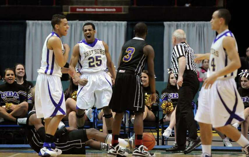 CBA's Earl Ricketts, #25, celebrates after Troy's Kareem Brown turns the ball over near the end of r