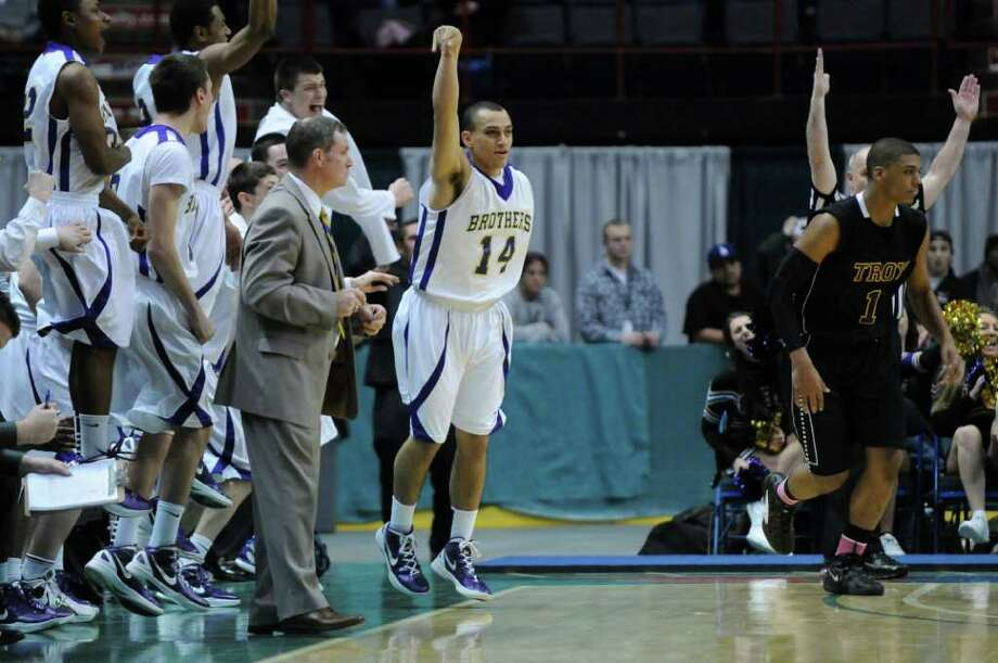 CBA's Chaz Lott, #14, celebrates after scoring near the end of the second half of their 62-57 overtime win over Troy in the Section II Class AA boys basketball final at the Times Union Center on Monday night March 5, 2012 in Albany, N.Y. CBA won their fourth straight Section II crown, and were in the finals for the 10th straight time. Duell played basketball for both CBA and Siena. (Philip Kamrass / Times Union ) Photo: Philip Kamrass / 00016679A