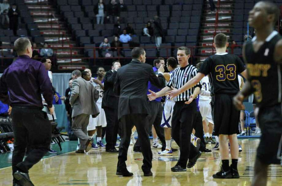 Troy coach Richard Hurley talks to an official on the court at the end of regulation of their 62-57 overtime loss to CBA in the Section II Class AA boys basketball final at the Times Union Center on Monday night March 5, 2012 in Albany, N.Y. Another  official called a technical foul on Hurley moments later, after he went back to the bench. CBA won their fourth straight Section II crown, and were in the finals for the 10th straight time. Duell played basketball for both CBA and Siena. (Philip Kamrass / Times Union ) Photo: Philip Kamrass / 00016679A