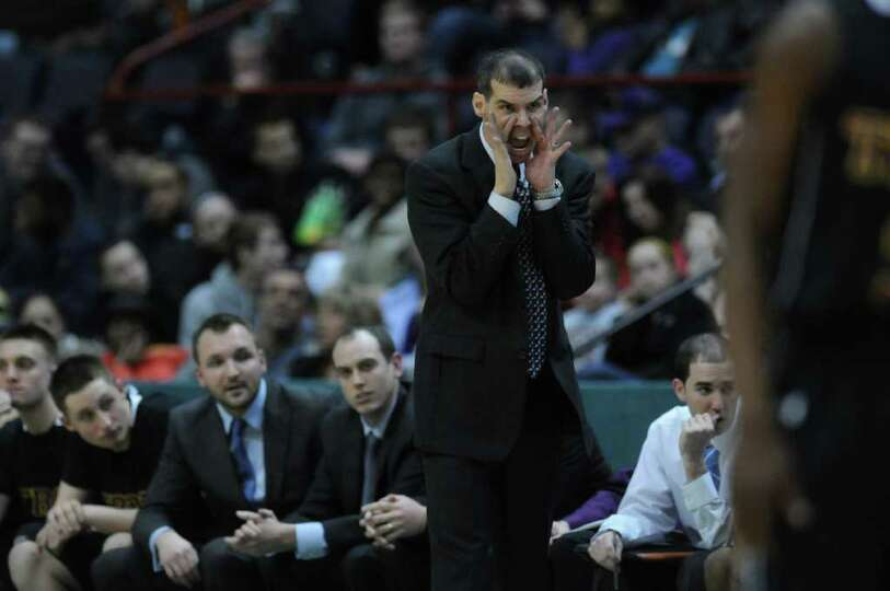 Troy coach Richard Hurley leads his team during their 62-57 overtime loss to CBA in the Section II C